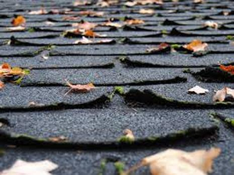 Curling Asphalt Shingles Venting Problem Skward Roofing NY